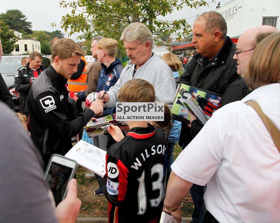 Eunan O'kane signs autographs before Bournemouth vs Watford on Saturday 3rd of October 2015.