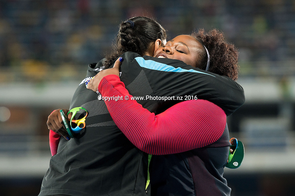 New Zealand's Valerie Adams (L) congratulates USA's Michelle Carter on her Gold medal during a medal ceremony for the Women's Shot Put in Olympic Stadium at the 2016 Rio Olympics on Saturday the 13th of August 2016. © Copyright Photo by Marty Melville / www.Photosport.nz
