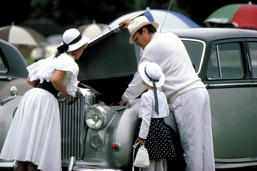 Family looking at Rolls Royce.Santa Barbara, CA