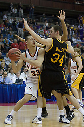 Virginia Cavaliers forward Jason Cain (33) is guarded by Albany Great Danes forward Brent Wilson (34).  The #4 seed Virginia Cavaliers defeated the #13 seed Albany Great Danes 84-57 in the first round of the South Region Men's NCAA Tournament in Columbus, OH on March 16, 2007.