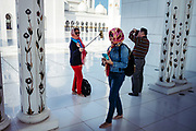 Abu Dhabi, United Arab Emirates (UAE), December 21, 2017. Tourists captivated by the Sheikh Zayed Mosque located in the capital city of United Arab Emirates, Abu Dhabi.
