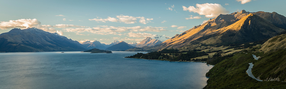 Sunlight graces the mountainous lakeside drive from Queenstown to Glenorchy.  Rated as one of the top drives in the world for great reason!