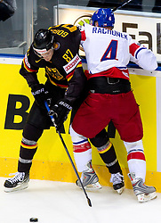 Philip Gogulla of Germany vs Karel Rachunek of Czech republic during ice-hockey match between Germany and Czech republic of Group E in Qualifying Round of IIHF 2011 World Championship Slovakia, on May 9, 2011 in Orange Arena, Bratislava, Slovakia.  (Photo By Vid Ponikvar / Sportida.com)