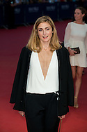 Julie Gayet poses on the red carpet as she arrives to attend the Premiere of 'Get on up'  during the 40th Deauville American Film Festival on September 12, 2014 in Deauville, France.