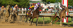 Nyquist with Mario Gutierrez up, center, yells while making the turn for the home stretch as he overtook Gun Runner with Florent Geroux up to win the 142nd running of the Kentucky Derby, Saturday, May 07, 2016 at Churchill Downs in Louisville.
