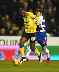 Wigan Athletic's Marc-Antoine Fortune is pursued by Reading's Oliver Norwood - Photo mandatory by-line: Paul Knight/JMP - Mobile: 07966 386802 - 17/02/2015 - SPORT - Football - Reading - Madejski Stadium - Reading v Wigan Athletic - Sky Bet Championship