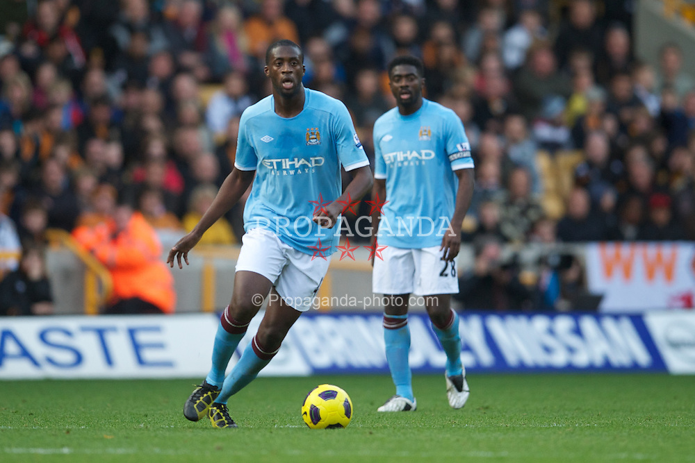 WOLVERHAMPTON, ENGLAND - Saturday, October 30, 2010: Manchester City's Yaya Toure and captain Kolo Toure during the Premiership match against Wolverhampton Wanderers at Molineux. (Pic by: David Rawcliffe/Propaganda)