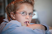 "Sept 8, 2008 -- COLORADO CITY, AZ: Members of the FLDS pulled their children from the public schools several years ago, now most of the families in town home school their children. The Jessops have almost 40 youngsters, in grades kindergarten through 8th grade, in their home school. Colorado City and the neighboring town of Hildale, UT, are home to the Fundamentalist Church of Jesus Christ of Latter Day Saints (FLDS) which split from the mainstream Church of Jesus Christ of Latter Day Saints (Mormons) after the Mormons banned what they call ""Celestial Marriage"" (polygamy) in 1890 so that Utah could gain statehood into the United States. The FLDS Prophet (leader), Warren Jeffs, has been convicted in Utah of ""rape as an accomplice"" for arranging the marriage of teenage girl to her cousin and is currently on trial for similar, those less serious, charges in Arizona. After Texas child protection authorities raided the Yearning for Zion Ranch, (the FLDS compound in Eldorado, TX) many members of the FLDS community in Colorado City/Hildale fear either Arizona or Utah authorities could raid their homes in the same way. Older members of the community still remember the Short Creek Raid of 1953 when Arizona authorities using National Guard troops, raided the community, arresting the men and placing women and children in ""protective"" custody. After two years in foster care, the women and children returned to their homes. After the raid, the FLDS Church eliminated any connection to the ""Short Creek raid"" by renaming their town Colorado City in Arizona and Hildale in Utah. The Jessops are a polygamous family and members of the FLDS.   Photo by Jack Kurtz / ZUMA Press"