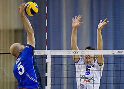 Antti Siltala of Finland  vs Alen Sket #5 of Slovenia during friendly volleyball match between National Teams of Slovenia and Finland on December 30, 2013 in Hala Tivoli, Ljubljana, Slovenia. The game was closed for public. Photo by Vid Ponikvar / Sportida
