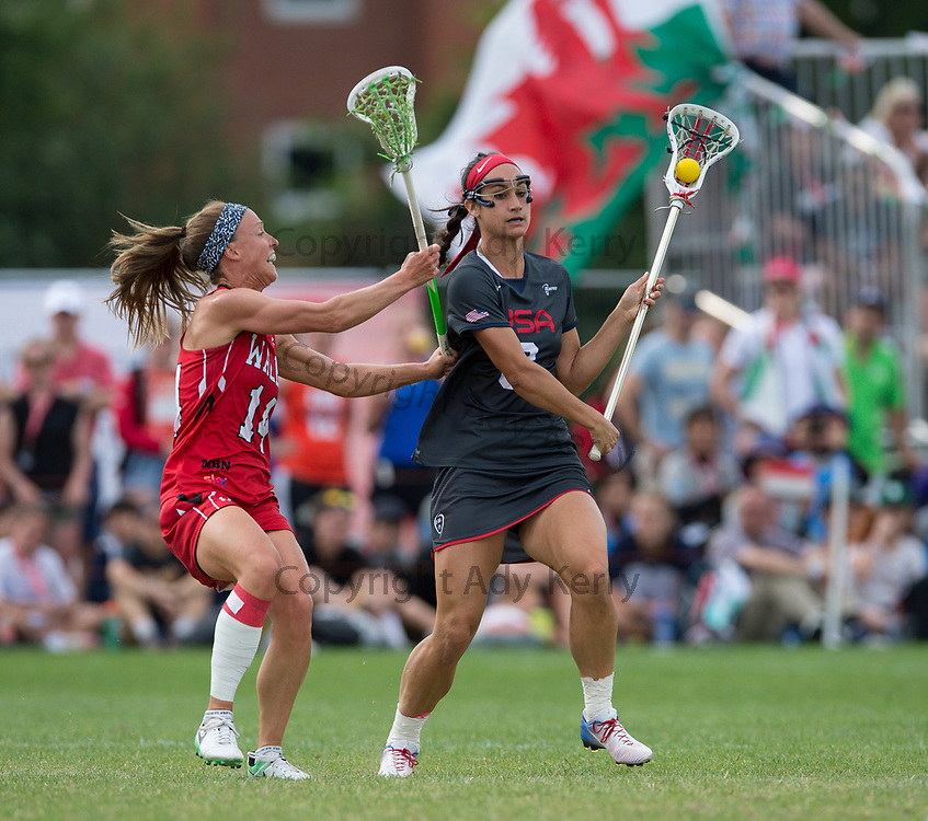 USA's Kristen Carr challenges with Wales' Becky Gaunt  at the 2017 FIL Rathbones Women's Lacrosse World Cup, at Surrey Sports Park, Guildford, Surrey, UK, 18th July 2017.