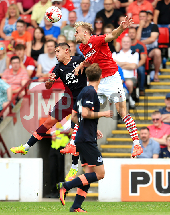 Marc Roberts of Barnsley challenges Muhamed Besic of Everton - Mandatory by-line: Matt McNulty/JMP - 23/07/2016 - FOOTBALL - Oakwell Stadium - Barnsley, England - Barnsley v Everton - Pre-season friendly
