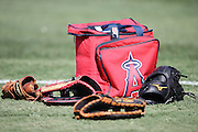 ANAHEIM, CA - AUGUST 21:  Los Angeles Angels of Anaheim gloves and a ball bag lie on the grass before the game against the Cleveland Indians on Wednesday, August 21, 2013 at Angel Stadium in Anaheim, California. The Indians won the game 3-1. (Photo by Paul Spinelli/MLB Photos via Getty Images)