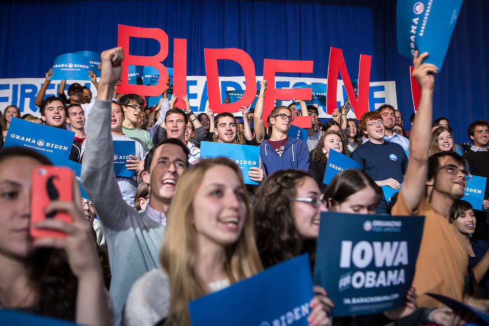 Audience members cheer as Vice President Joe Biden speaks at a rally at Grinnell College during a two-day campaign swing through Iowa on Tuesday, September 18, 2012 in Grinnell, IA.