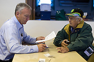 Hertz Real Estate Services real estate agent and auctioneer Marv Huntrods (from left) finishes the paperwork with Gaylord Jones of Eagle Grove, Iowa after a farm auction at the Eagle Grove Masonic Lodge in Eagle Grove, Iowa on Thursday, October 18, 2012. Jones purchased the eighty acre property for $848,000 at $10,600 per acre.