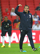Picture by John Rainford/Focus Images Ltd +44 7506 538356<br /> 14/08/2013<br /> Gary Neville of England leads the warm up before the International Friendly match at Wembley Stadium, London.