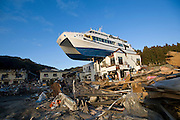 A pleasure boat sits atop a building after being washed inland by the March 11 tsunamis in Otsuchi, Iwate Prefecture, Japan. Photographer: Rob Gilhooly