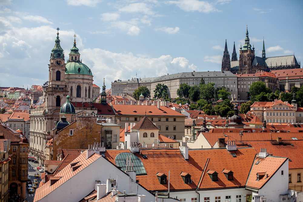 "View from a tower at the end of Charles Bridge to Mostecka street and the ""Lesser Town"" (Mala Strana). In the back the Church of Saint Nicolas (left) and Prague Castle."