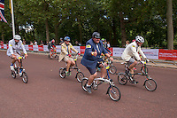 Riders coming off of the course at the end of the 10th Brompton World Championship Final on The Mall. Prudential RideLondon is the world's greatest festival of cycling, involving 95,000+ cyclists – from Olympic champions to a free family fun ride - riding in five events over closed roads in London and Surrey over the weekend of 1st and 2nd August 2015. <br /> <br /> Photo: Neil Turner for Prudential RideLondon <br /> <br /> See www.PrudentialRideLondon.co.uk for more.<br /> <br /> For further information: Penny Dain 07799 170433<br /> pennyd@ridelondon.co.uk