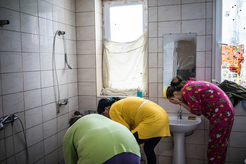 A shared bathroom is used for laundry and bathing at Romashka, a summer camp where several hundred people live after being displaced by fighting in Eastern Ukraine on Friday, February 13, 2015 in Kharkiv, Ukraine.