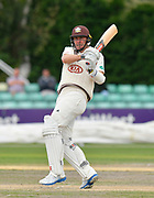 Rikki Clarke of Surrey hits the ball to the boundary for four runs during the final day of the Specsavers County Champ Div 1 match between Worcestershire County Cricket Club and Surrey County Cricket Club at New Road, Worcester, United Kingdom on 13 September 2018.