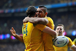 Kurtley Beale of Australia congratulates team-mate Adam Ashley-Cooper on his try before the score is ruled out - Mandatory byline: Patrick Khachfe/JMP - 07966 386802 - 18/10/2015 - RUGBY UNION - Twickenham Stadium - London, England - Australia v Scotland - Rugby World Cup 2015 Quarter Final.