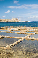 """Marsalforn Salt pans - locals harvest sea salt from these shallow """"fields"""" on the sea-shore"""