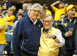 Jan 20, 2018; Morgantown, WV, USA; West Virginia University president Gordon Gee talks with West Virginia Secretary of Commerce Woody Thrasher before the start of the game against the Texas Longhorns at WVU Coliseum. Mandatory Credit: Ben Queen-USA TODAY Sports