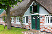 Painted door of traditional thatched cottage house on Fano Island - Fanoe - South Jutland, Denmark