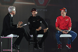 February 23, 2019 - Abu Dhabi, United Arab Emirates - Jonathan Edwards (Left), the event host, an Olympic, World, Commonwealth and European champion in triple jump, and a holder of the world record in the event since 1995, speaks with Tom Dumoulin (Center) and Dennis Rohan (Right)  and with during the Team Presentation, at the opening ceremony of the 1st UAE Tour, inside Louvre Abu Dhabi museum..On Saturday, February 23, 2019, Abu Dhabi, United Arab Emirates. (Credit Image: © Artur Widak/NurPhoto via ZUMA Press)