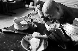 Chinese disabled artist Xi Fu eats by maneuvering utensils with his feet in his home in Daxing on the outskirts of Beijing, China 18 June 2013. Xi Fu does everything for himself with his feet, including personal chores and eating. Few people can master the art of Chinese calligraphy with good functioning hands, much less with their feet. Chinese disabled artist Xi Fu however, made it look like a piece of cake. The 34-year-old whose name meant 'Treasure Happiness' is a common sight in the underground passes of the bustling shopping district of Xidan or tourist walkways of Houhai in Beijing. Passers-by are mesmerize by his skillful display of calligraphic art using only his feet. Xi Fu's story is one that tells of how strong determination and hard work overcame the difficulties of surviving in a society scant with infrastructure and support for the disabled and where they are often discriminated and sidelined.