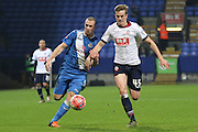 James Constable and Rob Holding battle during the The FA Cup Third Round Replay match between Bolton Wanderers and Eastleigh at the Macron Stadium, Bolton, England on 19 January 2016. Photo by Pete Burns.