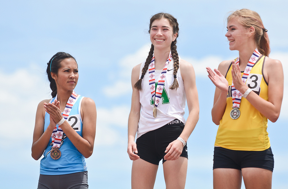 mkb051317p/sports/Marla Brose --  Albuquerque High's Alisa Meraz-Fishbein, center, is congratulated on the podium after beating Cleveland's Amanda Mayoral, left, and Cibola's Nicole Lawrence, right,  after the 6A 800 meter run on the final day of the NMAA State Track & Field Championships, Saturday, May 13, 2017, in Albuquerque, N.M.  (Marla Brose/Albuquerque Journal)