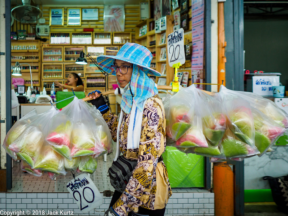 17 SEPTEMBER 2018 - BANGKOK, THAILAND: A woman selling Thai style dessert roti in the Klong San market, next to the ICONSIAM development. ICONSIAM is a mixed-use development on the Thonburi side of the Chao Phraya River. It is expected to open in 2018 and will include two large malls, with more than 520,000 square meters of retail space, an amusement park, two residential towers and a riverside park. It is the first large scale high end development on the Thonburi side of the river and will feature the first Apple Store in Thailand and the first Takashimaya department store in Thailand. Rents for shopkeepers in Klong San market are up to 30,000 Thai Baht per month (about $920US) and some in Bangkok are concerned that Klong San Market will lose its local character when the huge mall opens.     PHOTO BY JACK KURTZ