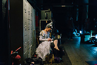 "PALERMO, ITALY - 18 FEBRUARY 2018: Ballerina Simona Filippone sews her ballet shoes backstage during the dress rehearsal of ""Don Quixote"" at the Teatro Massimo in Palermo, Italy, on February 18th 2018.<br /> <br /> The Teatro Massimo Vittorio Emanuele is an opera house and opera company located  in Palermo, Sicily. It was dedicated to King Victor Emanuel II. It is the biggest in Italy, and one of the largest of Europe (the third after the Opéra National de Paris and the K. K. Hof-Opernhaus in Vienna), renowned for its perfect acoustics. It was inaugurated in 1897."