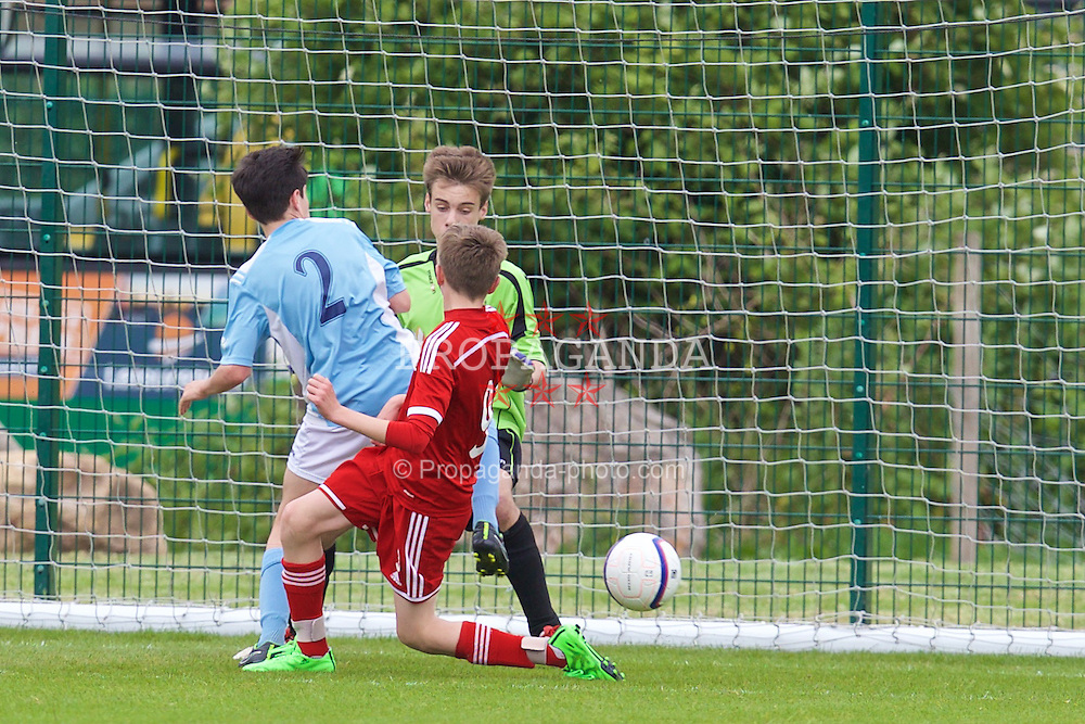 NEWPORT, WALES - Wednesday, May 27, 2015: South WPL Academy Boys' Jac Davies scores an own goal during the Welsh Football Trust Cymru Cup 2015 at Dragon Park. (Pic by David Rawcliffe/Propaganda)