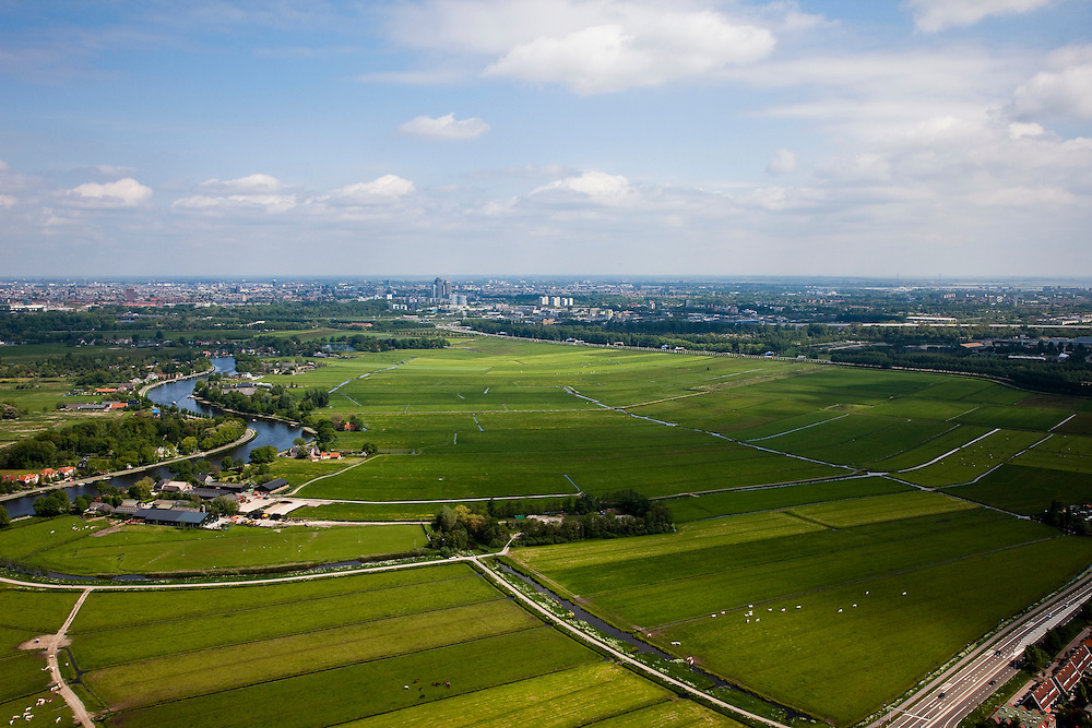 Nederland, Amsterdam, Zuidoost, 25-05-2010. Groot en Klein Duivendrechtse Polder, onder de rook van Amsterdam, ten oosten van Amstelveen.  Links de Amstel, Zuid-as met wolkenkrabbers rond het Amstelstation aan de horizon. .Polders, last empty space immediately south of Amsterdam. Left the river Amstel, Zuid-as business centre with skyscrapers in the distance..luchtfoto (toeslag), aerial photo (additional fee required).foto/photo Siebe Swart