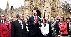 (L-R) Newly Elected MP for Wythenshawe and Sale East Mike Kane MP speaks with Labour leader Ed Miliband outside of The House of Commons on College Green, London, UK with members of the Labour party behind.<br /> Monday, 24th February 2014. Picture by Elliott Franks / i-Images
