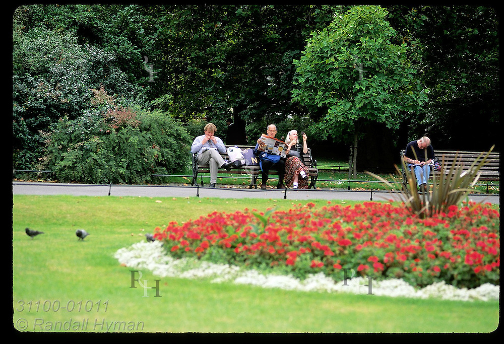 People relax on benches at St. Stephen's Green on a September afternoon; Dublin, Ireland.