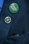 Badges of support - The market reopening is signified by the ringing of the bell and is attended by Mayor Sadiq Khan. Tourists and locals soon flood back to bring the area back to life.