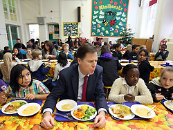 © Licenced to London News Pictures. 04/12/2013. London. UK.  <br /> Deputy Prime Minister Nick Clegg is pictured eating lunch with children during his and schools minister David Laws' visit to the Walnut Tree Walk Primary School in London, December 4th 2013. The Deputy Prime Minister announced in September that one of his key priorities for the Autumn Statement was to provide free school meals to every infant school pupil.<br /> Photo Credit: Susannah Ireland