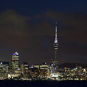 An early evening view of the skyline of the City of Auckland and Auckland Harbour showing Sky Tower. Auckland, North Island, New Zealand. 12th November 2010. Photo Tim Clayton