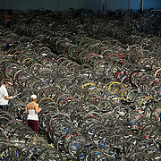 June 16, 2012 - Waterville, Maine : Participants in the 2012 Trek Across Maine check on their bicycles, in storage in the fieldhouse at Colby College in Waterville, Maine, on Saturday night. The fundraiser -- the American Lung Association's largest -- sent over 2000 riders cycling across Maine this past weekend. Karsten Moran for the American Lung Association of Maine