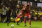 Reece Grego-Cox (Crawley Town)  leaps on the back of Nathan Ferguson (Crawley Town)  in celebration of their win during the EFL Cup match between Crawley Town and Norwich City at The People's Pension Stadium, Crawley, England on 27 August 2019.