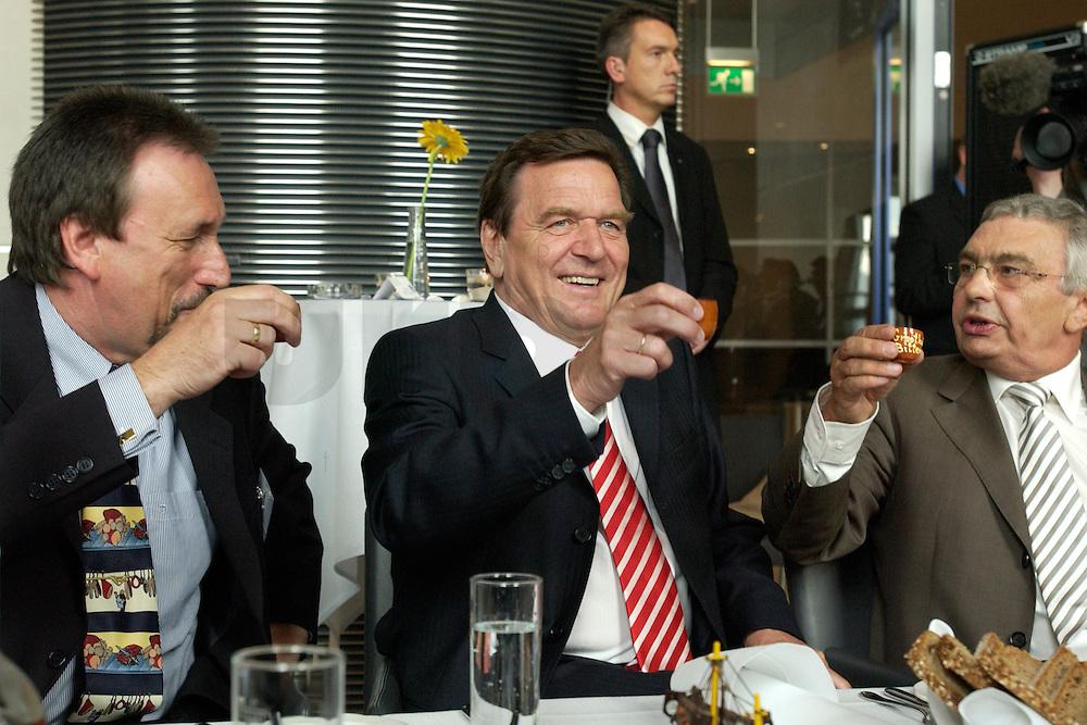 27 APR 2004, BERLIN/GERMANY:<br /> Gerhard Schroeder (M), SPD, Bundeskanzler, Reiner Alberts (L), Regional-Marketing Norderfleisch, Jann-Peter Janssen (R), MdB, SPD, aus dem ostfriesischen Wahlkreis Aurich-Emden, trinken einen Schnaps Marke &quot;Grootheider Bittern&quot;, waehrend dem Eroeffnungsabend der 1. kulinarischen Ostfriesland-Woche, Abgeordneten-Restaurant des Deutschen Bundestages, Rechstagsgebaeude<br /> IMAGE: 20040427-04-014<br /> KEYWORDS: Gerhard Schr&ouml;der, Regional-Marketing Norderfleisch, Parlamentarischer Abend, Alkohol, Getr&auml;nk, Getraenk