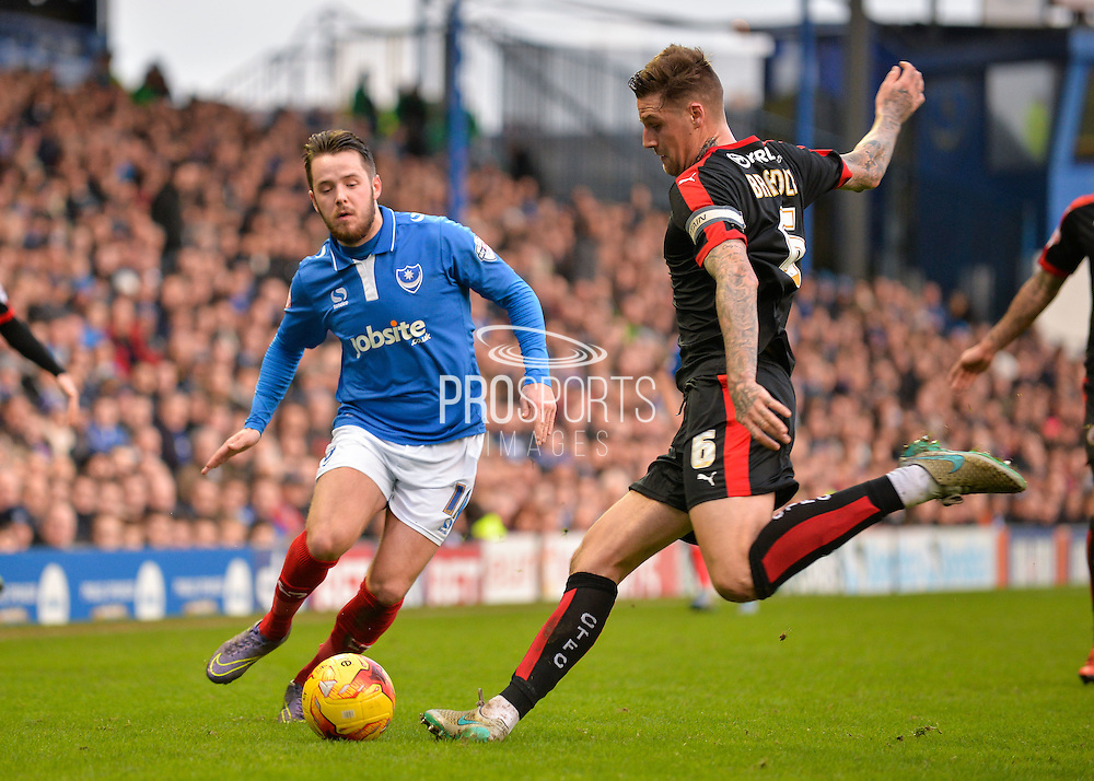 Crawley Town Defender Sonny Bradley and Portsmouth striker Marc McNulty during the Sky Bet League 2 match between Portsmouth and Crawley Town at Fratton Park, Portsmouth, England on 2 January 2016. Photo by Adam Rivers.