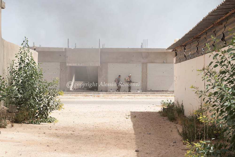 Libya: Fighters affiliated with Libya's Government of National Accord's (GNA) advance in 700 neighbourhood in Sirte. Alessio Romenzi