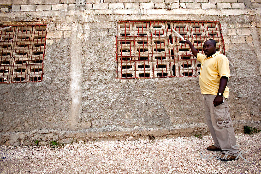 "Guito St. Georges, security officer for the campus of the Presbyterian Mission in Haiti, a church-planting and school-building ministry, points at how high  the flood waters hit the buildings..The campus lost nearly everything to the floods. President of PMH Charles Amity thanks God that although he lost most of his buildings and vehicles, his life and the lives of his family members were saved.  ""With the help of friends and churches, we were able to rebuild one house and repair three others for families,"" said Amity. ""We helped people to cover the funeral expenses of loved ones that passed away in the flood and we provided counseling for the community. In addition, we provided free health care for the whole community with the support of several medical teams from Canada and United States."""