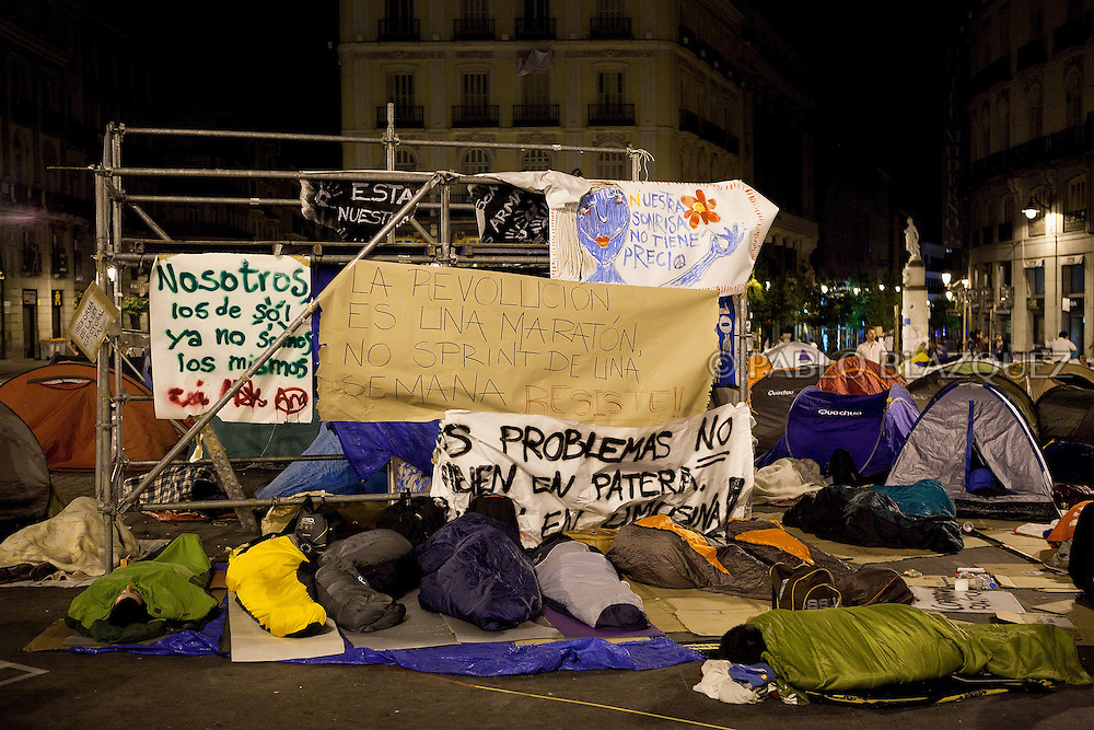 Protesters camp at the Puerta del Sol square in Madrid in the early hours on May 24, 2011 during a continued demonstration against Spain's economic crisis and its sky-high jobless rate. Protesters describe themselves as the 'indignant', and are known variously as 'M-15' in reference to their demonstration's birth date, 'Spanish Revolution' and 'Real Democracy Now'. Spain's ruling Socialists sustained spectacular local election losses on May 22 as protesters vented outrage over the highest jobless rate in the industrialized world. ©Pablo Blazquez