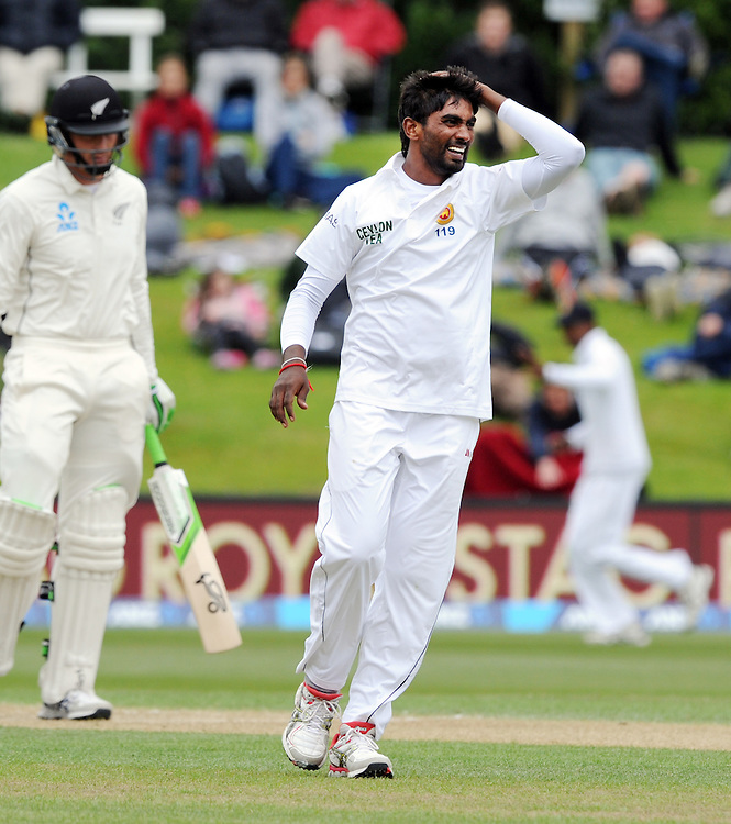 Sri Lanka's Numan Pradeep frustrated during his bowling at New Zealand on day three of the first International Cricket Test, University Cricket Oval, Dunedin, New Zealand, Saturday, December 12, 2015. Credit:SNPA / Ross Setford