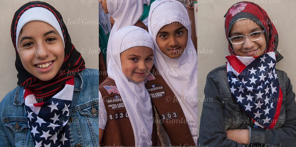 Three portraits of smiling American Muslims. They are some  of the many faces of people showing their ethnic pride who were marching in the 2014 Muslim Day Parade in New York.<br />
